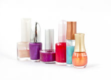 Six bottles of nail polish. Six colorful bottles of nail polish on white background with shallow depth of field Stock Photo