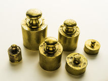 Six brass weights of an old weighing scale. Weights measured in kilograms Royalty Free Stock Photos
