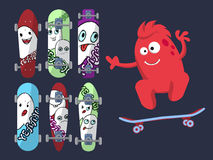 Six bright skateboard with pictures of cute ghosts on a dark background with a red monster. Vector Royalty Free Stock Images