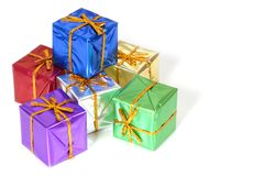 Six brightly colored wrapped Christmas packages. Isolated on white Stock Images