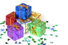 Six brightly colored wrapped Christmas presents. With holiday confetti isolated on white Stock Photography
