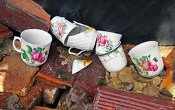 Six broken cups. Six colorful old broken cups in the garbage Stock Images