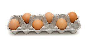Six brown eggs in box isolated Stock Image