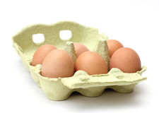 Six brown eggs in the package. On white background stock photo