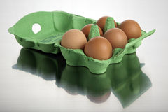 Six brown eggs in their box Stock Photos