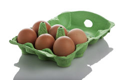 Six brown eggs in their box isolated Royalty Free Stock Photos