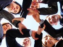 Six businesspersons holding their hands together Stock Photos