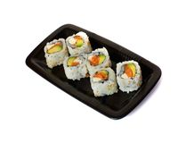 Six california rolls on a plate. Isolated on white Royalty Free Stock Photography