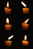 Six candles. Closeup of burning candles on dark background Stock Photography