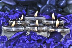 Six Candles in spa environment Royalty Free Stock Images