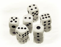 Six casino dices. On a reflective table Royalty Free Stock Photo