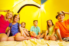 Six children having fun in a tent Stock Image