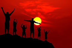 Six children jumping mountain sunset Stock Image