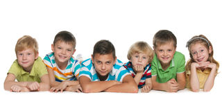 Six children. Are lying on the floor on a white background Stock Photos