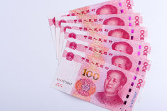 Six Chinese 100 RMB notes arranged as fan isolated on white back Stock Photos