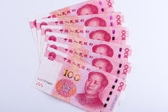 Six Chinese 100 RMB notes arranged as fan isolated on white back. Six Chinese currency 100 RMB Yuan notes arranged as fan isolated on white background, centered royalty free stock photography