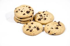 Six chocolate chip cookies just sitting there lost. A cookie is a baked or cooked food that is small, flat and sweet. It usually contains flour, sugar and some Royalty Free Stock Images