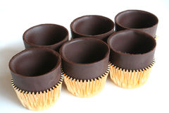 Six chocolate cups. Chocolate cups on a white background Royalty Free Stock Image