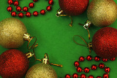 Six christmas balls and red beads Stock Images