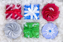 Six Christmas gift boxes in fluffy padding Royalty Free Stock Image