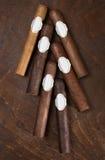 Six cigars. A dark background Royalty Free Stock Photos