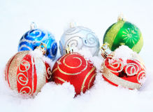 Six coloful Colorful Christmas ball in snow Royalty Free Stock Images