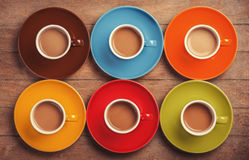 Six color cups. Of coffee on wooden table Stock Photo