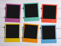 Six color polaroids. Six color polaroid frames on wooden background Stock Photos