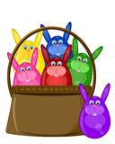 Six Colored Happy Easter Bunny Eggs in Basket Stock Photography
