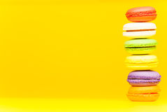 Six colored macarons standing on each other Royalty Free Stock Image