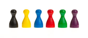 Six colored pawns Royalty Free Stock Photos