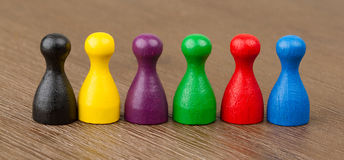 Six colored pawns isolated Royalty Free Stock Photos