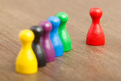 Six colored pawns isolated Stock Photography