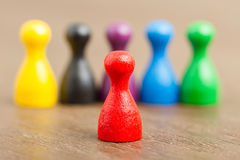 Six colored pawns, red in front Stock Images