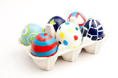 Six Colorful Easter Eggs in an Eggbox. Six colorful, hand painted Easter eggs in an egg carton Royalty Free Stock Photos