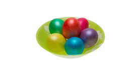 Six Easter eggs on a green plate, isolated Stock Images