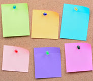 Six colorful empty notes. On cork Royalty Free Stock Photo