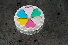 Six colorful multicolored hearts on the white plate Royalty Free Stock Photography