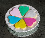 Six colorful multicolored hearts on the white plate Royalty Free Stock Photo