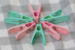 Six Colorful Plastic Clothes Peg Royalty Free Stock Images