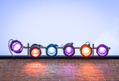 Six colorful spotlights. In front of blue sky - with space for text Royalty Free Stock Photo