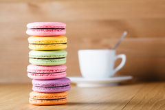 Six colorfull french macaron and cup Stock Image
