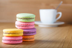 Six colorfull french macaron and cup Stock Photo