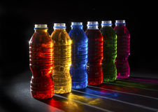 Six coloured bottles backlit Royalty Free Stock Photos