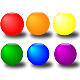 Six colourful Buttons. Six colourfull buttons in the colours red, yellow, orange, green, blue purple. All are in isolaltion with shadows underneath Royalty Free Stock Photography