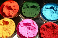Six colours. Six pots of coloured pigment Royalty Free Stock Image