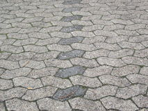 Six cornered asymmetric plaster (Parking space). Six cornered asymmetric plaster stones as parking space surface seen in perspective with dark stones Royalty Free Stock Photography