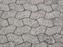 Six cornered asymmetric plaster. Stones as parking space surface Royalty Free Stock Photos