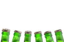 Six cous verts de bouteille avec des capsules Image stock