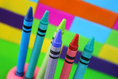 Six Crayons. Propped up in clay against a building block wall Stock Images